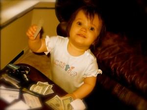 cutie pie holding american dollars money