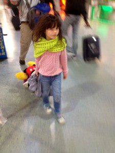 little girl with a suitcase in an airport
