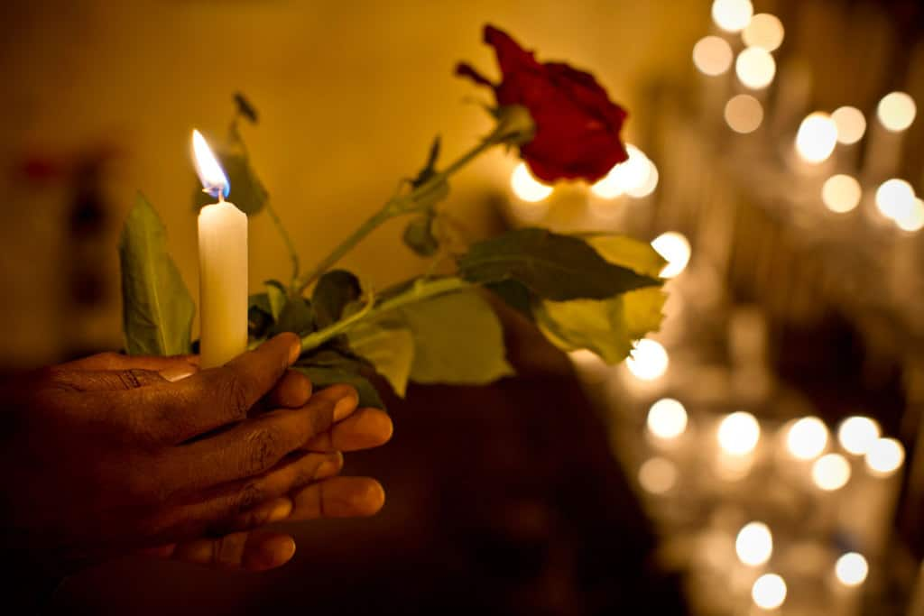 A candlelit vigil is held for people who died in the terrorist siege on Westgate Shopping Centre at Ukay Nakumatt Nairobi, Kenya  on September 28, 2013. Kate Holt.