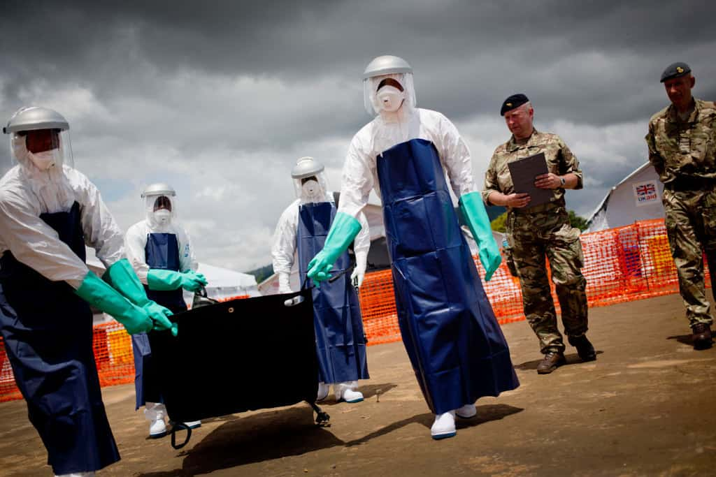 Members of the  Combined Joint Inter Agency Task Force  (ISAT) from the British military take part in a demonstration of an emergency field ebola treatment centre. Kate Holt.