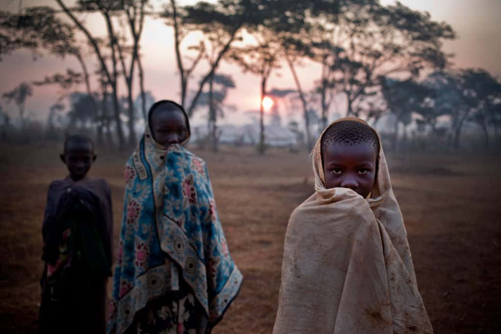 Refugees who have fled ongoing political unrest in Burundi go about their early morning tasks in the Nyagurusu Refugee camp  in  Mekere, Tanzania Tuesday, June 9, 2015. Kate Holt.