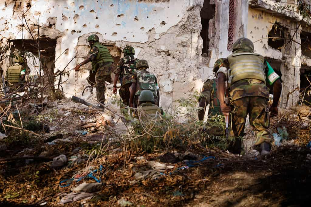 AMISOM soldiers advance on the frontline in the Sigaale District of Mogadishu, Somalia on December 15th, 2010. Kate Holt.