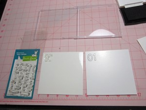 Stamping new stamps onto cd case inserts and placing on panels