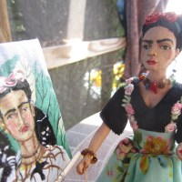 Frida is painting