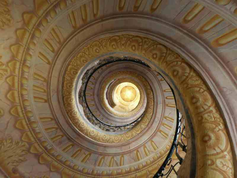 Looking upwards at a spiral staircase
