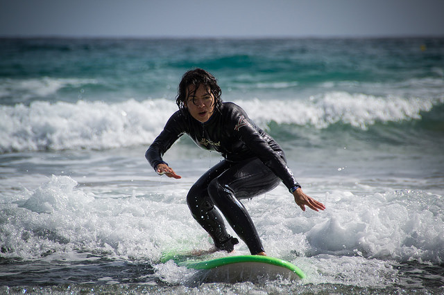 female on a surf board