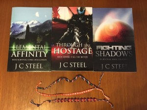 The Cortii series by J. C. Steel and hand-woven bookmarks