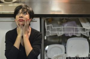 Distressed housewife next to open dishwasher
