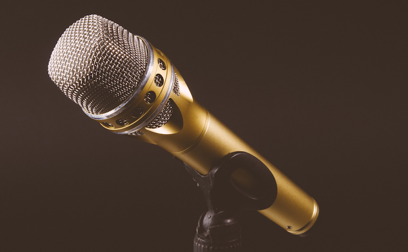 Gold microphone on a microphone stand