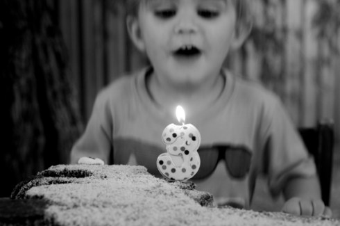 birthday boy blowing the candle