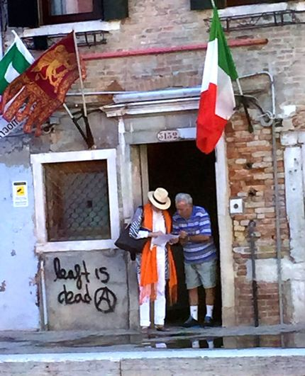Well dressed tourist asking directions from a local.  Campo San Barnaba.
