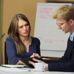 stock-footage-business-briefing-man-woman-search-for-solution-office-meeting