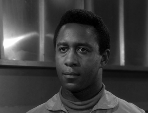 Robert DoQui as Captain Frank Johnson in The Outer Limits episode, The Invisible Enemy.