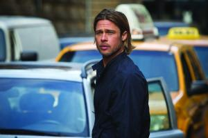 World War Z - Gerry Lane (Brad Pitt) standing in front of cars looking concerned