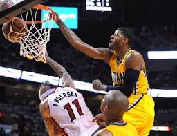 Paul George throws down an NBA Jam dunk on the head of Miami forward Chris Anderson