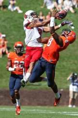 Ball State's Willie Snead (3) catches the ball over a Virginia defender Saturday. / Geoff Burke-USA TODAY Sports
