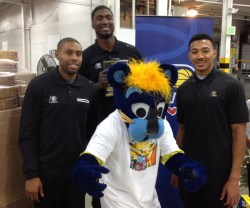 (from left to right) Pacers C.J. Watson, Roy Hibbert, Boomer, and Orlando Johnson pose for pictures after handing out toys to kids, and loading a truck with more.