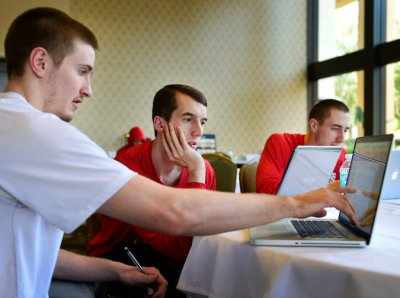 This NY Times pic shows Wisconsin basketball players celebrating their trip to the Final Four by studying.