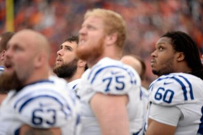 Andrew Luck listens to the National Anthem in the same spot where he operated successfully today - behind his offensive line.