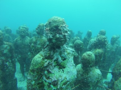 Coral growth on statues. Marine Preserves such as this one in Cancun can preserve biological and cultural resources simultaneously in a naturally artistic way.
