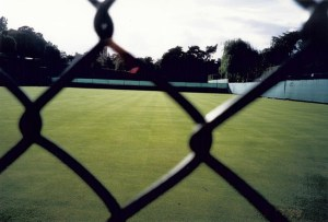 Wimbledon practice courts as seen through a fence on my way into the Wimbledon Museum