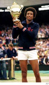 Arthur Ashe with his Wimbledon trophy circa 1975