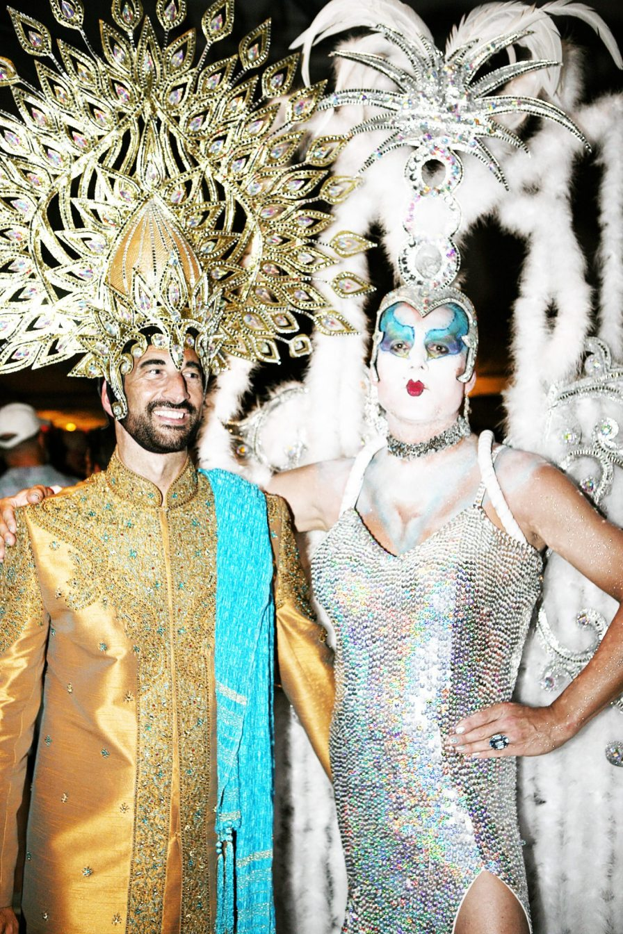 Andy Celli and Kai Schrade sport two of the more glamorous headdress outfits competing for the coveted $1,500 prize.