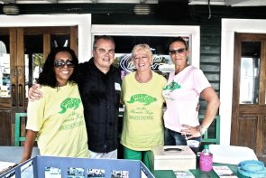 Sunset Social Drinking Club's Ben Hennington's presence is enhanced by the lovely volunteers of Save-A-Turtle — Marlene Durkzo, Monica Gerodzinski and Denise Capone.