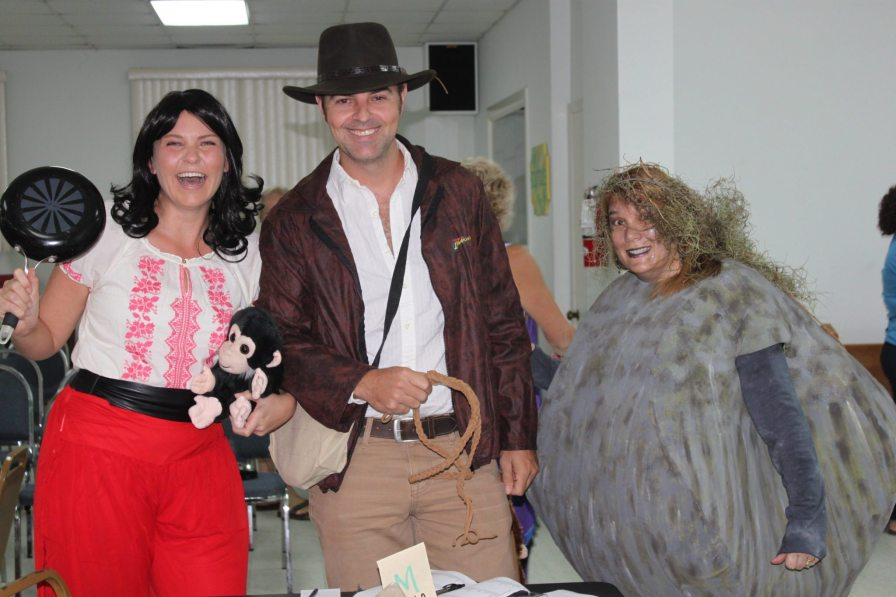 """The team of Sarah Czimas (Marion Ravenwood), left, Doug Mayer (Indiana Jones) and Jeanine Mothner, (""""the boulder"""") are in high spirits before the start of the contest."""