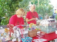 Relay for Life volunteers Maureen Holland and Cindy Widmaier sell raffle tickets to win gift baskets. Both ladies work at the hospital: Maureen is the RN house supervisor and Cindy is a radiation tech.