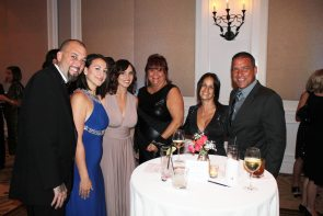 Eric and Victoria Castellanos, Jessica Horan, Joyce Benavides and Letisia and Steve Powell share a photo op.