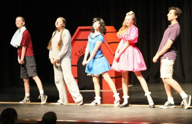 """The opening number of """"Charlie Brown"""" brings in the singing and dancing by Hannah Gracy, Mackenzie Helms, Claire McCarthy, Ariana Patterson, and John Galjanic."""