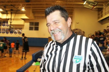 Referee Jon Murphy does his best to keep the flagrant fouls by the visiting team to a minimum.