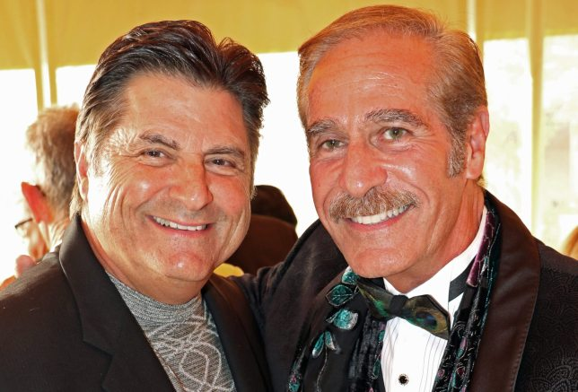 Doctor Bruce Boros and the Butterfly Conservatory's George Fernandez pose for a picture.