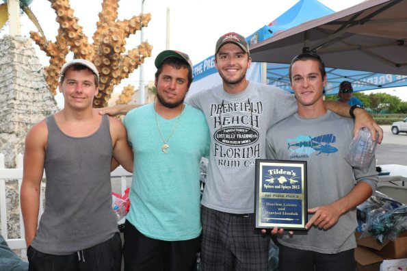 Kyle Freeman, left, places second and third place in the men's division, Brandon Freeman Is the grand prize winner, Colin Haley Is the funky bunch winner with a slipper and spotted lobster and Alec Getman Is the men's first place winner.