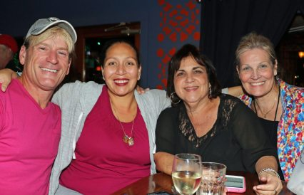 Supporters Michael Stella, left, Tanya Leto, Rose Suca, and Helen Garcia help out at Bottle Cap Lounge's Blue Room.