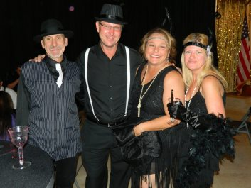 Gangsters Mike Resnick and Randy Lewis, and flappers Maria Brandwold and Lena Resnick, raise funds for a good cause.