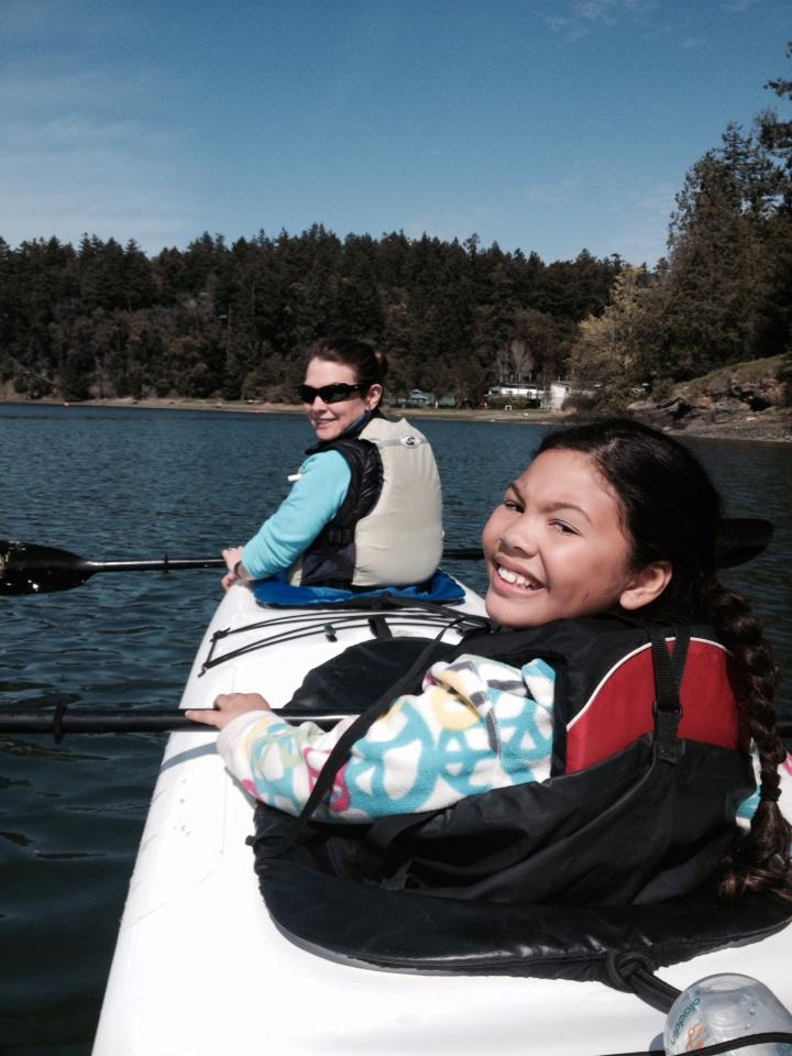 Jeanine and Asia exploring the waterways in double kayak.