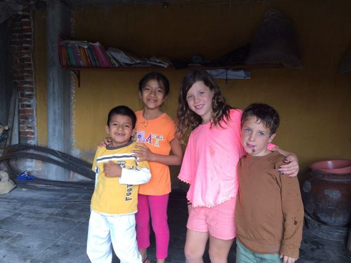 Riley and Merrit making friends with Teotitlán kids during the tour.