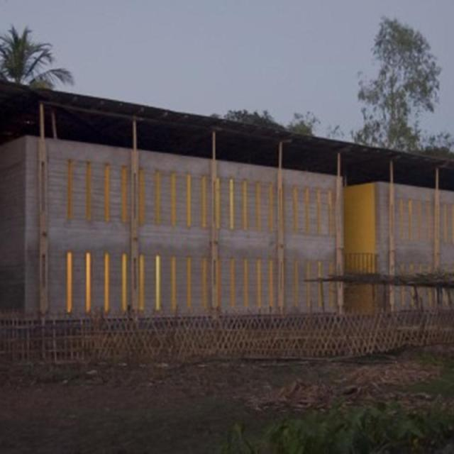 54e67cf3e58ece33a800004a_pani-community-centre-schilderscholte-architects_pani_community_centre_bangladesh_south_facade_twilight_schilderscholte_archit-530x332 (Copy)