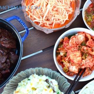 Korean BBQ party table with Kalbi, Radish Salad, Kimchi and Potato Salad