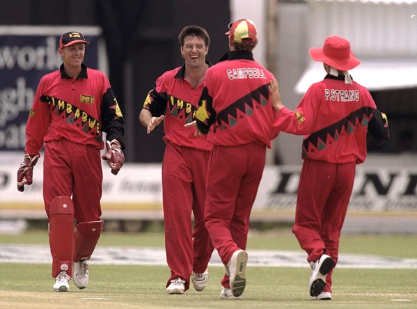 15 Dec 1996:  John Rennie of Zimbabwe takes the wicket of Allan Mullally for 0 during the one day international against Zimbabwe at Bulawayo, Zimbabwe. Mandatory Credit: Clive Mason/Allsport