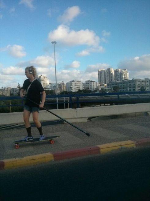 Sweet Baby Jesus.  Blondini paddling over the bridge on the new Skate Bike.  Radio sold separately,