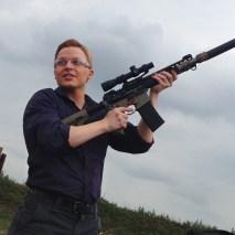 Ronan holding gun