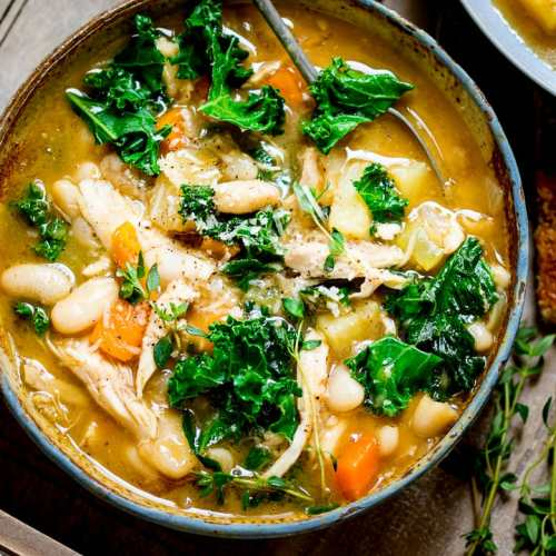 Tuscan Style Chicken Soup - a hearty soup with veggies and beans to warm up your belly!