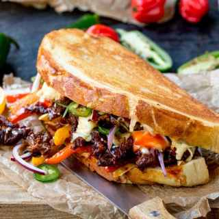 This Korean Steak Sandwich with Jalapenos and Garlic Mayo is roll-your-eyes-in-your-head amazing! Marinated rib eye steak and a kick of chilli heat!