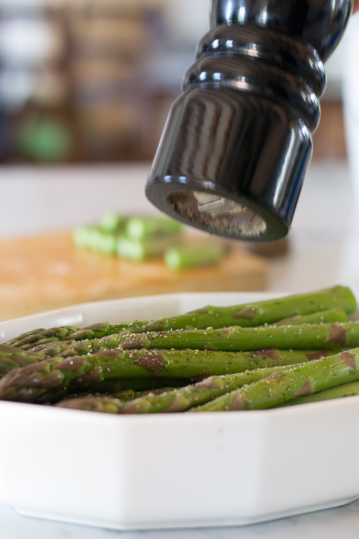 crack pepper on asparagus