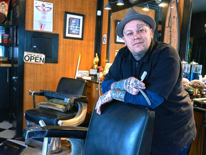 """This is where I hope to be cutting hair when I'm eighty-five,"" says Devon Hayter, the man behind the chair at The Brooke. ""I hope to pass this on to someone else who will keep this as a barber shop."" Photo by Ellen Bond"