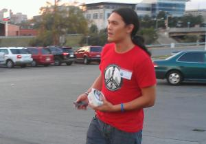 Antonio Buehler arrives wearing a red peaceful streets t-shirt.
