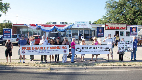 Free Bradley Manning signs at Banners along a sidewalk